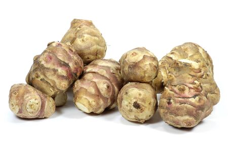 mellowness: jerusalem artichokes isolated on white background