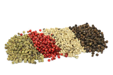 peppercorns: different colored peppercorns isolated on white background