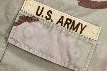 american army: US Army patch on desert uniform Stock Photo