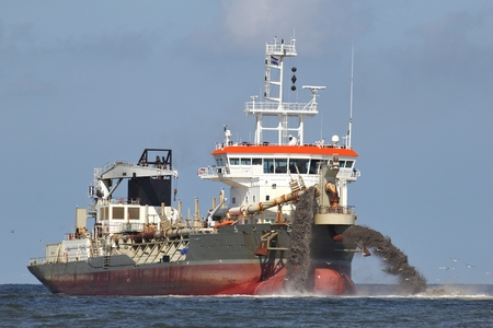coastal erosion: trailing suction hopper dredger creating country