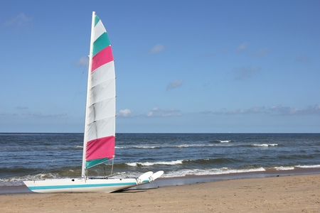catamaran: catamaran on sandy beach