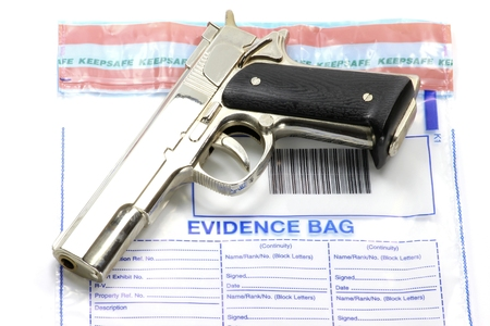 background csi: handgun to be put into evidence bag