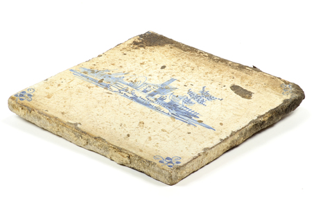 delft: antique hand painted Delft tile isolated on white background