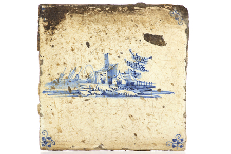 delftware: antique hand painted Delft tile isolated on white background