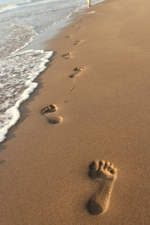 impermanent: footprints in the sand