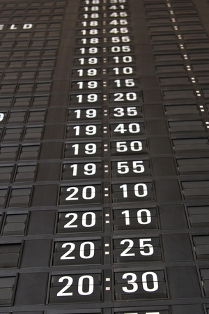 split rail: destination board at airport Stock Photo