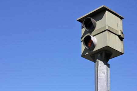 stationary speed camera against blue sky Foto de archivo