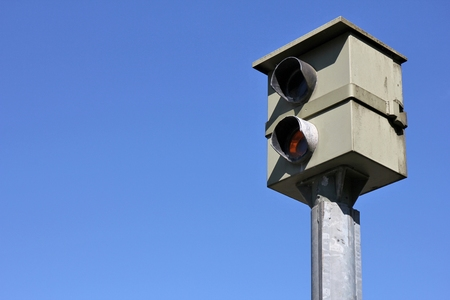 stationary speed camera against blue sky Banque d'images
