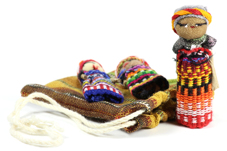 traditional worry dolls made in Guatemala isolated on white background