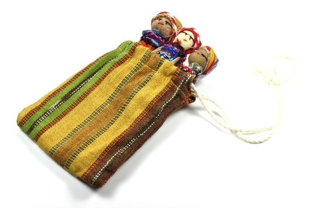 legends folklore: traditional worry dolls made in Guatemala isolated on white background