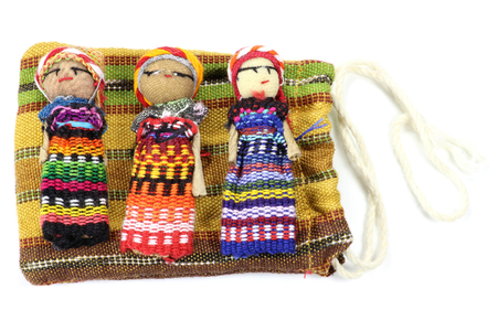 trouble free: traditional worry dolls made in Guatemala isolated on white background