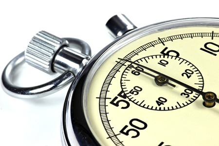 analogous: analogue stopwatch against white background