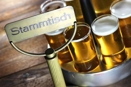 specialty: table reserved for regular guests in a German pub with Koelsch served specialty beer from Cologne Stock Photo