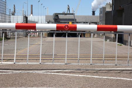 sluice: closed boom barrier at sluice Stock Photo