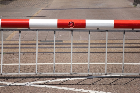 closed boom barrier at sluice Stock Photo