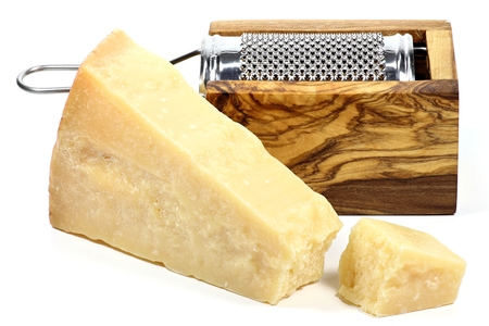 hard cheese: Italian hard cheese with grater isolated on white background