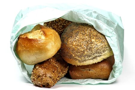 bolsa de pan: fresh bread rolls in paper bag isolated on white background Foto de archivo