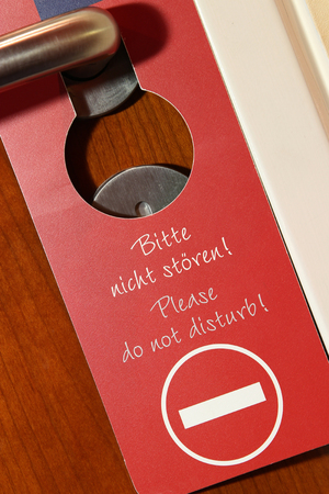 do not disturb sign: do not disturb sign on the door of a hotel room