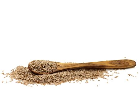 psyllium: wooden spoon with fleawort seeds isolated on white background Stock Photo