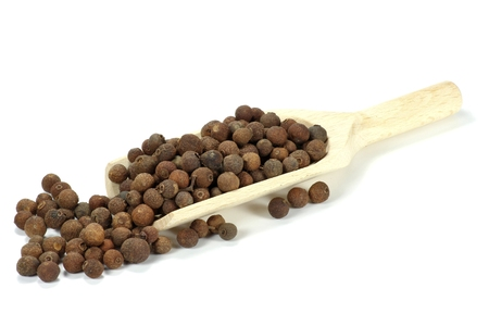 wooden scoop: wooden scoop with allspice isolated on white background