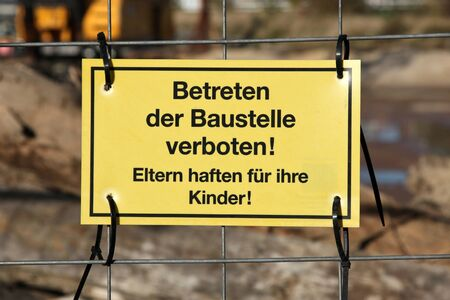 or not: yellow warning sign at German construction site