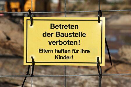 yellow warning sign at German construction site