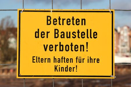 building sector: yellow warning sign at German construction site