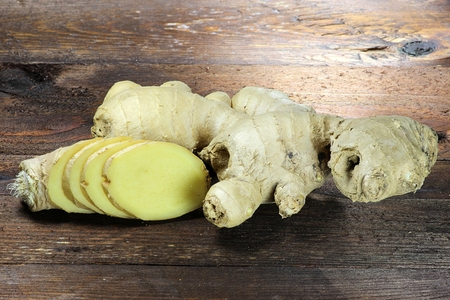 mellowness: ginger rhizome on wooden background