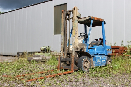 stored: disused fork lifter stored outdoors