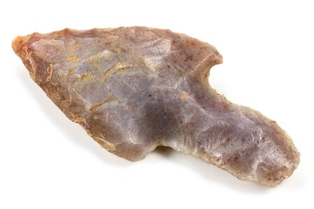 archaeologist: neolithic arrowhead isolated on white background Stock Photo