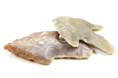 archaeologist: neolithic arrowheads isolated on white background