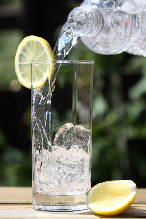 seltzer: sparkling water pouring into glass Stock Photo