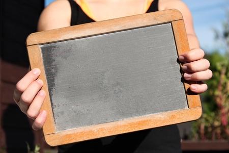 blank slate: blank slate shown by young female