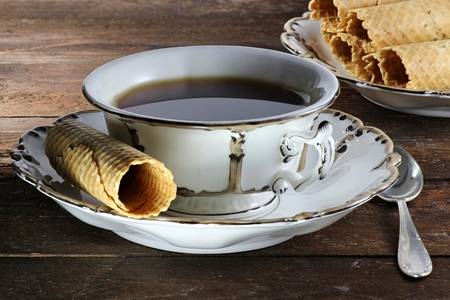 black tea served with traditional East Frisian New Year waffles in a beautiful ancient cup of the mid 19th century