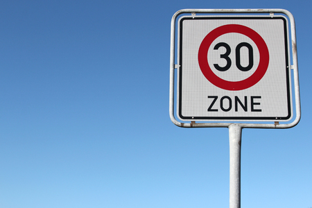 restrictive: German road sign: start of a 30 km  h zone