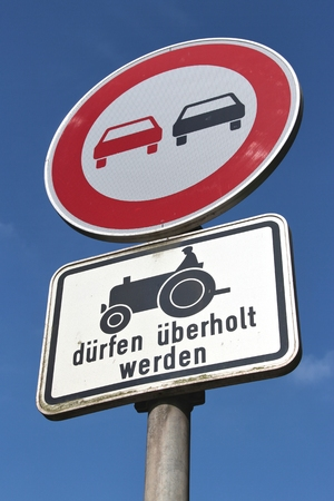 overtaking: German road sign: no overtaking - slow vehicles allowed to pass Stock Photo