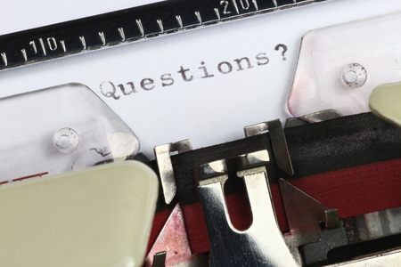 questions: Questions? written with old typewriter Stock Photo