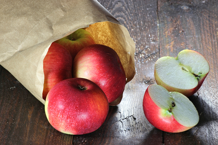 mellowness: apples (variety Elstar) in a paper bag on wooden background