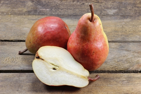 mellowness: pears (variety red bartlett) on wooden background Stock Photo