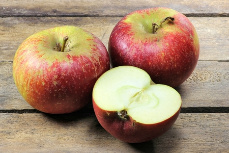 mellowness: apples (variety Ingrid Marie) on wooden background