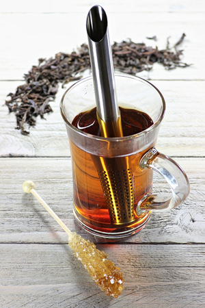 brewed: black tea brewed in glass on wooden background Stock Photo