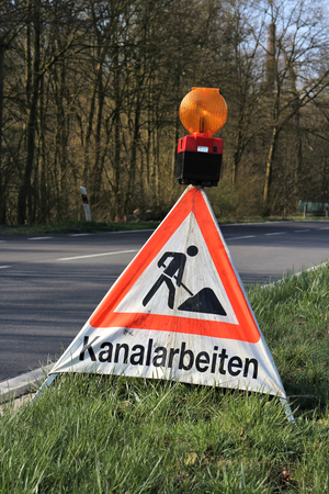 sewer: German road sign: construction site - working at sewer system