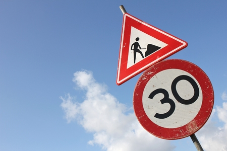 Dutch road sign: speed limit 30 km  h in combination with roadworks ahead