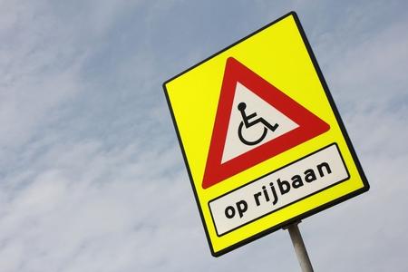 emphasized: Dutch road sign: wheelchair user crossing