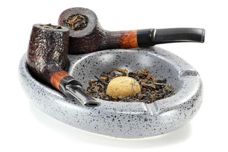 ashtray: briar pipes on ashtray isolated on white background Stock Photo