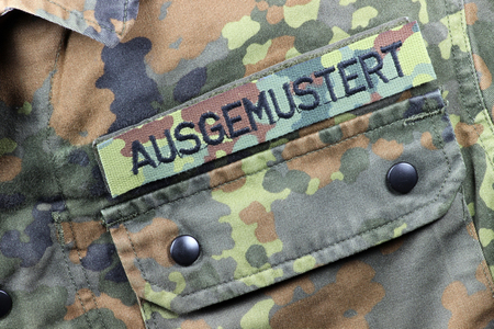 withdrawn: German camouflage uniform jacket patched WITHDRAWN FROM SERVICE instead of name tag Stock Photo
