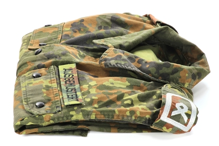 suitability: German camouflage uniform jacket patched WITHDRAWN FROM SERVICE instead of name tag Stock Photo