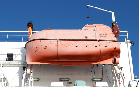 lifeboat of an oceangoing freighter Stock Photo
