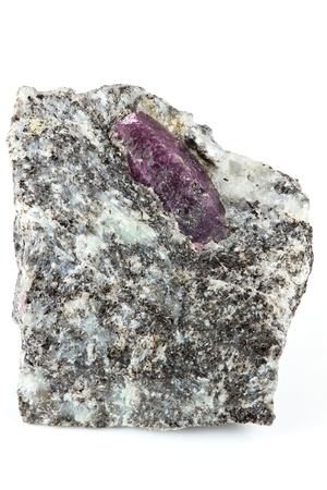 nestled: ruby nestled in bedrock found in Mysore  India Stock Photo
