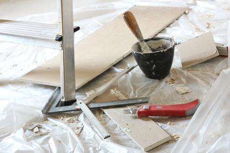 box cutter: tools needed for drywall installation Stock Photo